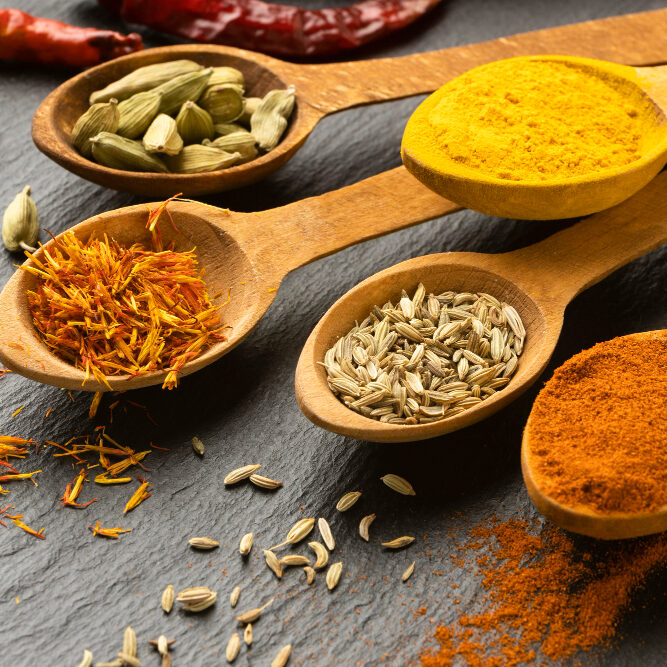 high-angle-indian-spices-with-spoons (1)
